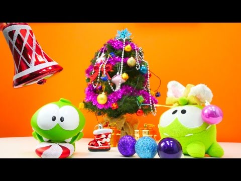 Çizgi film oyuncakları. Om Nom Yıl başı Ağacı süslüyor. Eğitici ve eğlenceli çocuk oyunları izle!