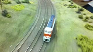 both n scale locos pacing shot around corner