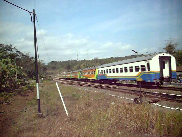 Indonesia Railway -Kereta Api Kutojaya Selatan Crossing Road  Stasiun Ijo.MOV Travel Video