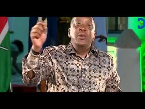 Woman crawls behind President Uhuru Kenyatta during live interview