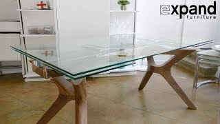 Bridge extending glass table with wood legs