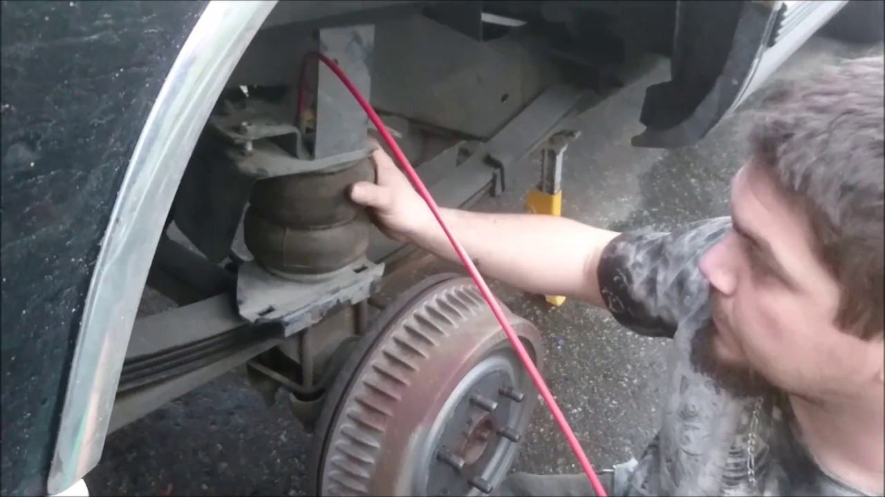HOW TO INSTALL AIR BAG SUSPENSION CHEVY TAHOE - YouTube
