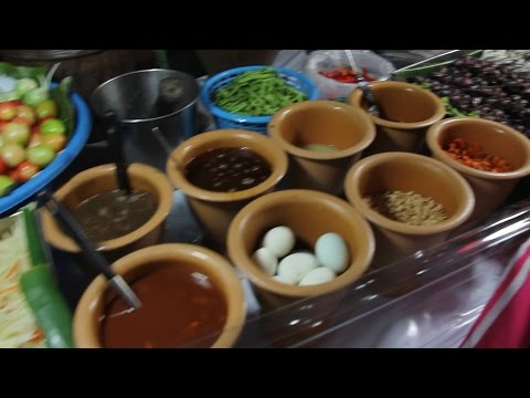 Thai Street Food at a Fair in Thailand. Street Food Shopping at a Thai Night Market in Hat Yai