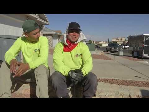 Roofers work on an El Paso, Texas roof in 102 degrees barefoot