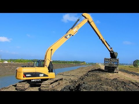 Long Reach Excavator Digging Widening River Canal CAT 320D L