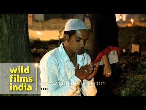 Man praying in front of his ancestor