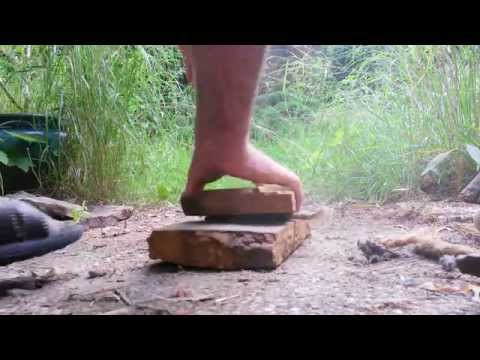 Fire by bamboo & rocks - fire roll technique - 90% primitive