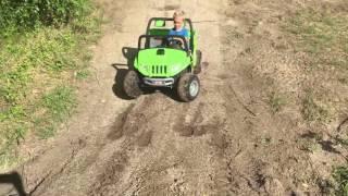 "Eli mudding the ""Artic Cat"" (power wheels)"