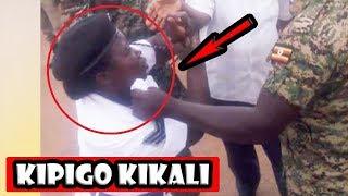 INAHUZUNISHA SANA Trafik Apokea Kipigo cha Mbwa Koko Kutoka kwa Wanajeshi wa Balozi wa Uganda