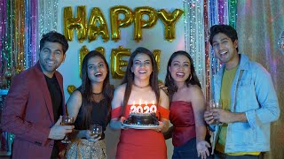 Group of young boys and girls celebrating New Year Eve with drinks at a house party in India