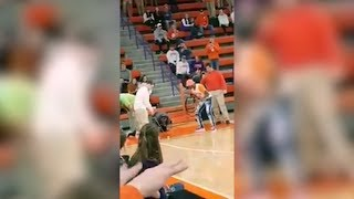 Fans Lose It When Student Wins $10,000 Getting Hole-In-One Across Basketball Court