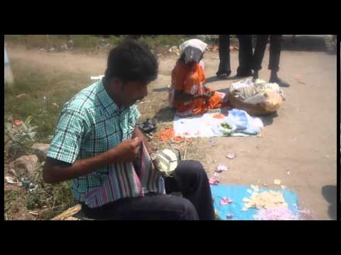 Indian street small merchant selling vegetable cutter