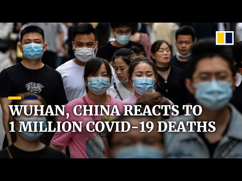 China's Wuhan moves on as global coronavirus death toll passes 1 million
