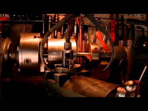 Regrooving grain roller mill
