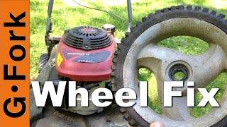 Lawnmower Repair : Fix A Broken Wheel : Gardenfork.tv