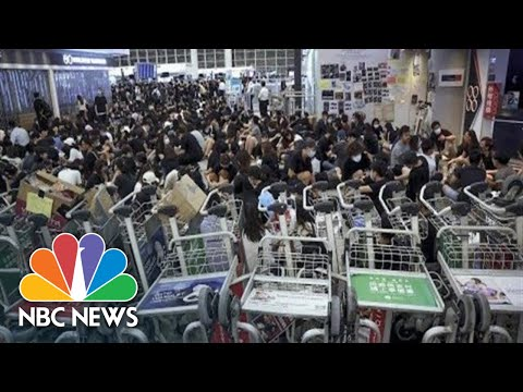 Watch live: Riot police clash with protesters at Hong Kong airport
