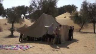 Putting up the Bedu tent at the base of the Arabian desert expedition