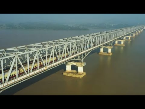 Yangon train to Mawlamyine running on Thanlwin bridge. Myanmar drone video