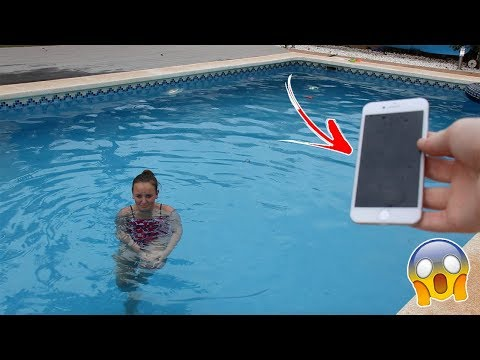THROWING LITTLE SISTERS IPHONE IN POOL😱 *PRANK*