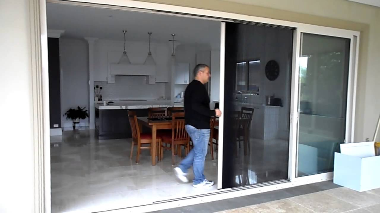 & retractable fly screen Type B single panel on stacker doors - YouTube