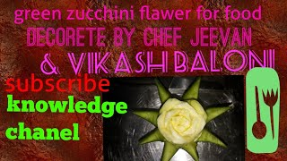 Carving art in green zucchini garnishing food  by knowledge channel