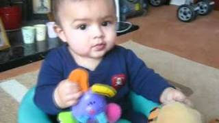 Baby Sean Oliver in bumbo chair