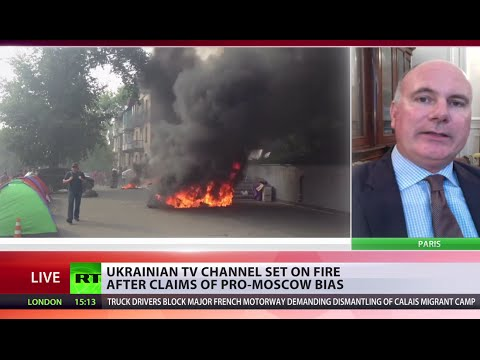 One of Ukraine's largest TV channels set on fire, under siege after claims of pro-Moscow bias