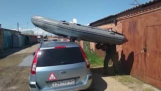 Перевозка лодки на машине