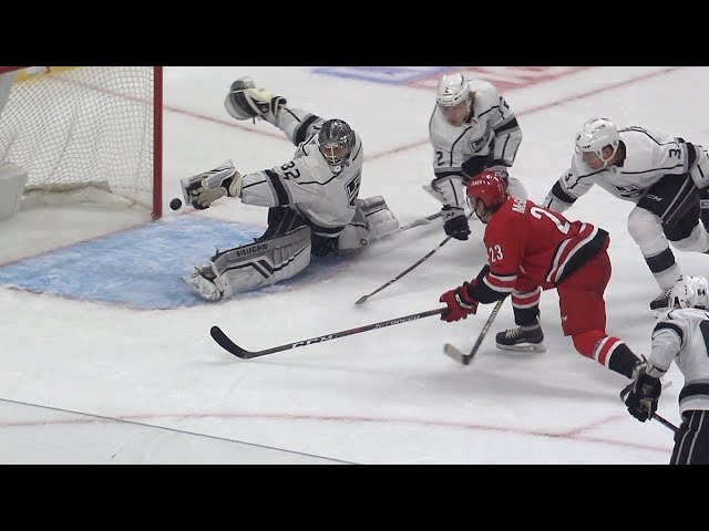 Jonathan Quick extends for spectacular fingertip save with blocker
