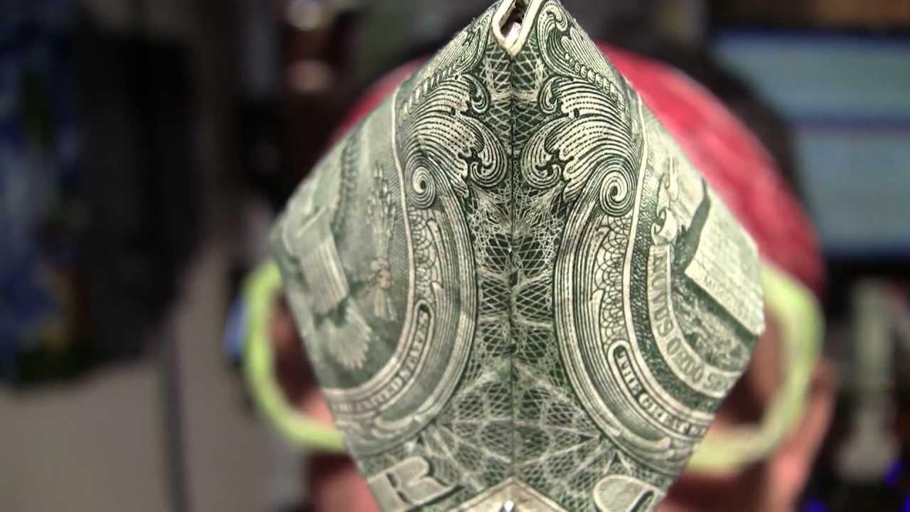 Bohemian grove owl on dollar bill