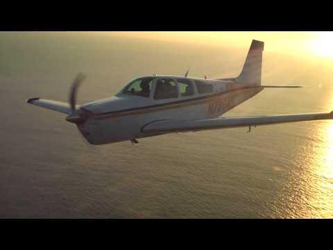 Flying Bonanza F33 at Sunset over the coast in Malibu