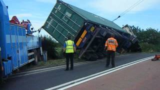 44ton Scania R470 artic pulled back onto its wheels after turning over