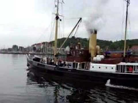 Bussard, 102 year old steamship blowing her whistle