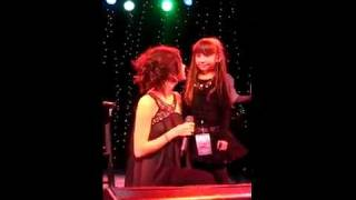 Selena Gomez singing A Year without Rain with a little girl