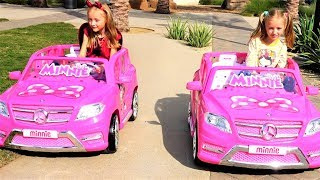 Polina plays with her twin sister and rides Minnie car