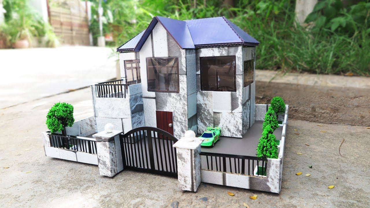 Building a beautiful modern house by using cardboard dream house school project