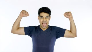 Excited Indian man happily doing winning gesture against the white background