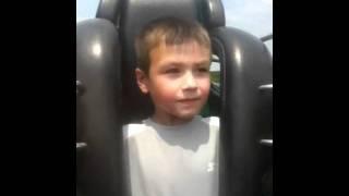 little boy first roller coaster ride