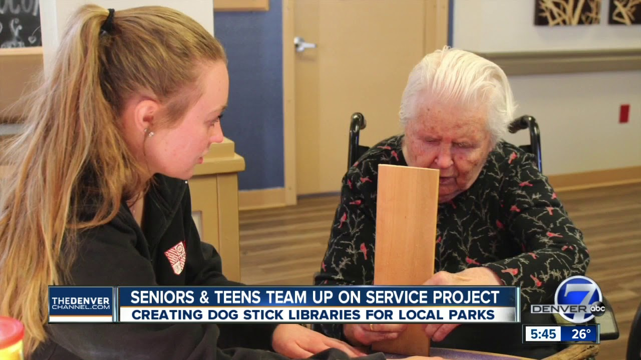 Seniors & students making stick libraries for dogs