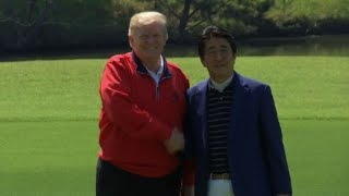Trump tees up Japan summit with Abe golf match