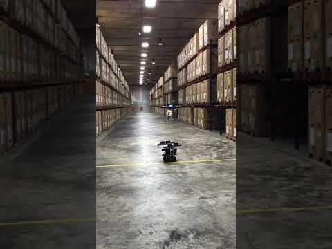 Infinium Scan Drone landing autonomously in a warehouse - automated inventory stock-taking by drones