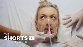"A Deaf woman undergoes a medical procedure to ""cure"" her deafness. 