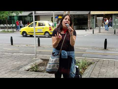 """Amazing street singer performing """"Amor Eterno"""" in Medellín, Colombia."""