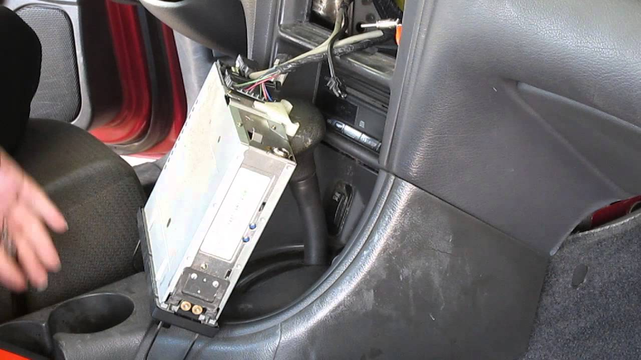 uninstall and reinstall a 1998 1999 2000 oem ford mustang radio cassette player stereo [ 1280 x 720 Pixel ]