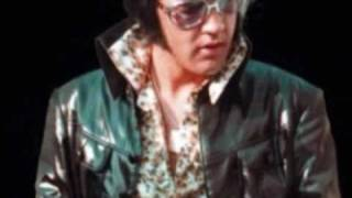 Elvis Presley -T-R-O U-B L-E.