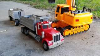 Excavator & Peterbilt dump truck