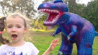 Ulyana play with dinosaur and magic wand