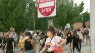Protesters clash with police in Detroit after deadly officer involved shooting