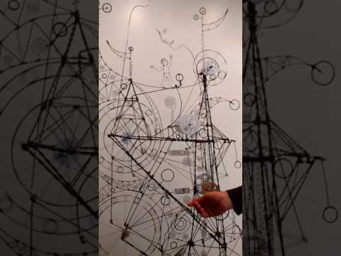 Bet you haven't seen anything like this before! Wire sculpture goes around and around...