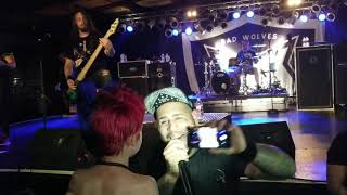 Tommy Vext from Bad Wolves singing with a kid